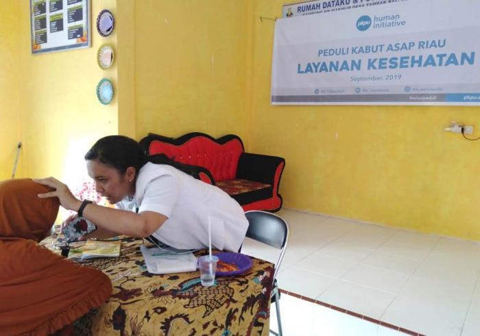 Human Initiative  Berikan Layanan Kesehatan dan berbagi masker N95 di 9 Wilayah Terdampak Kabut Asap